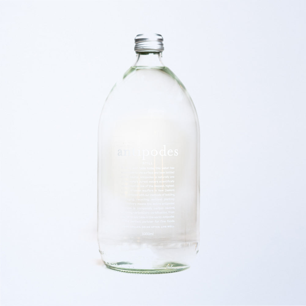 a 1l glass bottle of antipodes still water.
