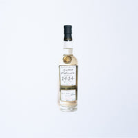 A 750ml ArteNOM Seleccion 1414 Reposado Tequila.