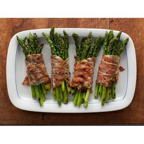 bunches of roast asparagus wrapped in bacon