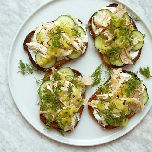 Open sandwiches with dip and slices of celery.