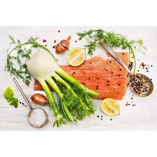 A bulb of fennel with a side of salmon, onions, pink peppercorns, lemons, all looking fresh and delicious.