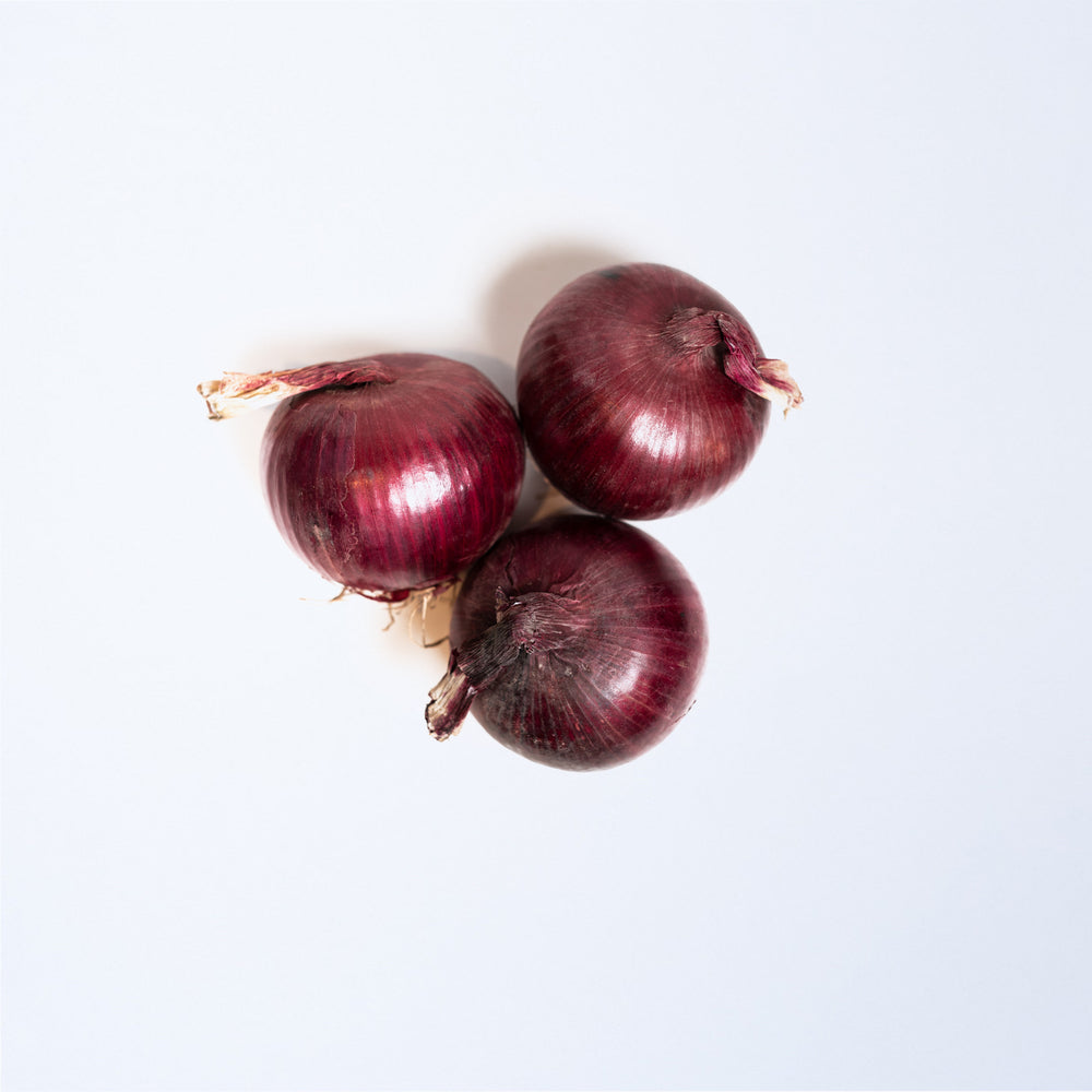 Three red onions.