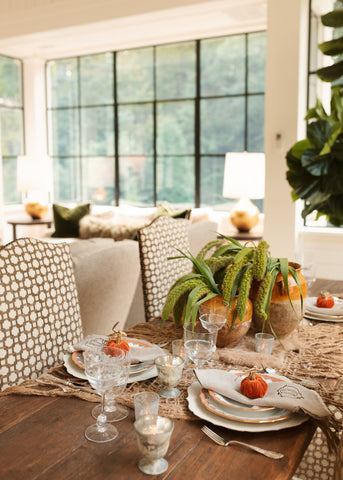Fall tablescape in shades of orange and green.