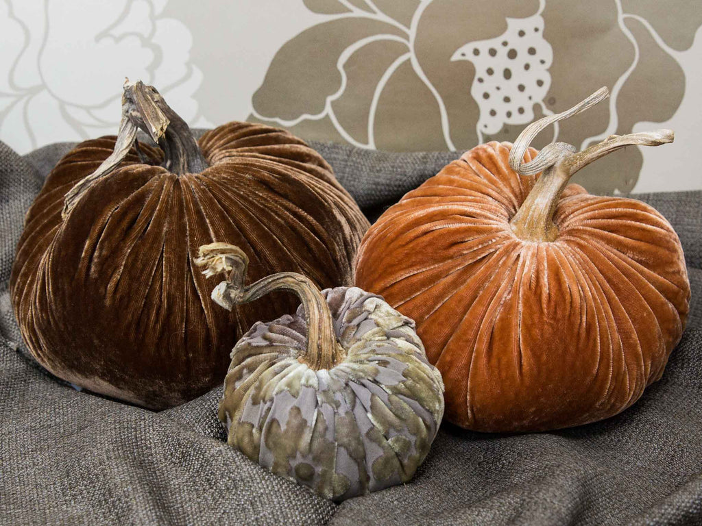 Orange and brown fabric pumpkins. Autumn velvet pumpkins in brown and orange.