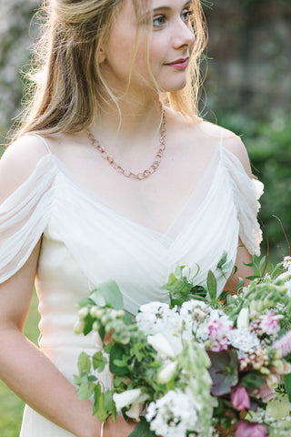 Bride modelling Emily Nixon Pebble Drawing Necklace.