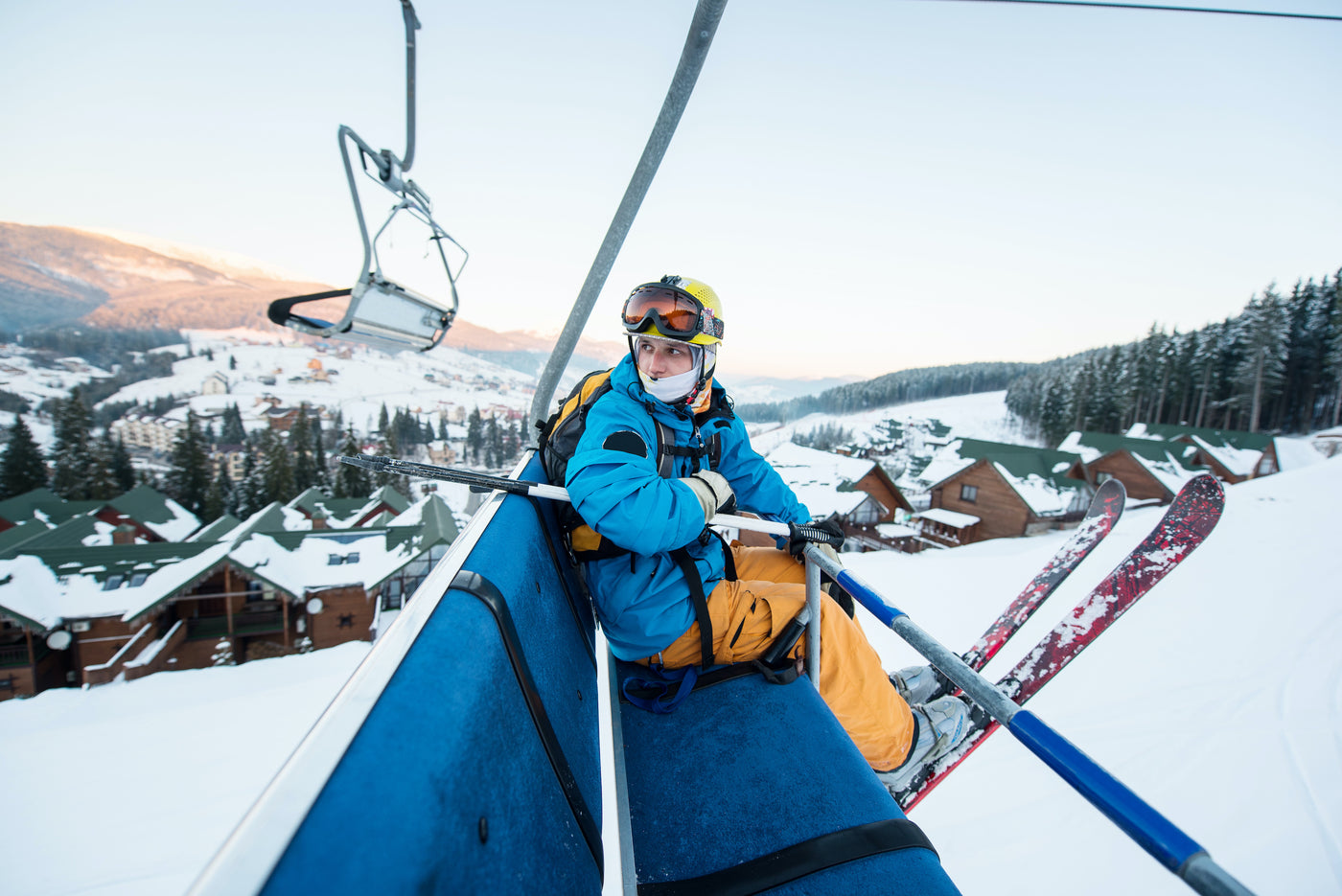 Skier posing on a ski lift