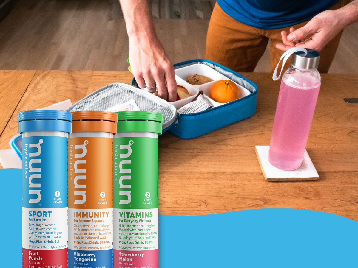 Lunchbox being packed with waterbottle of Nuun