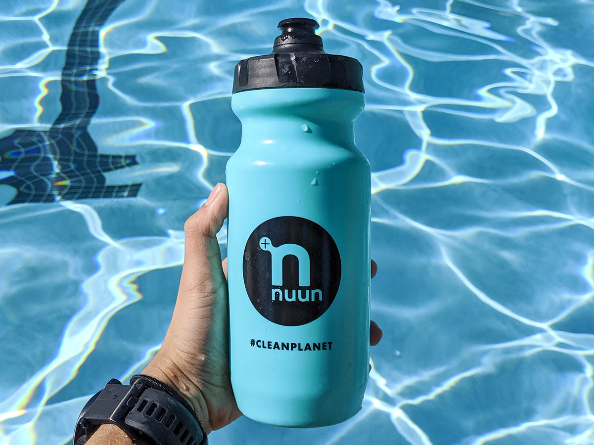 Nuun water bottle in front of a swimming pool