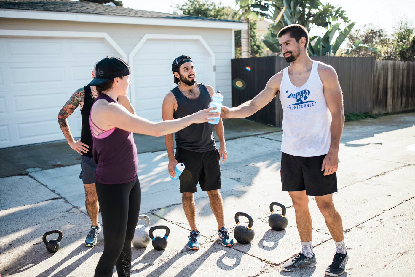 People talking and hydrating during a crossfit workout