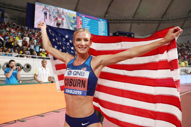 Emma Coburn holding a USA flag at the World Championship