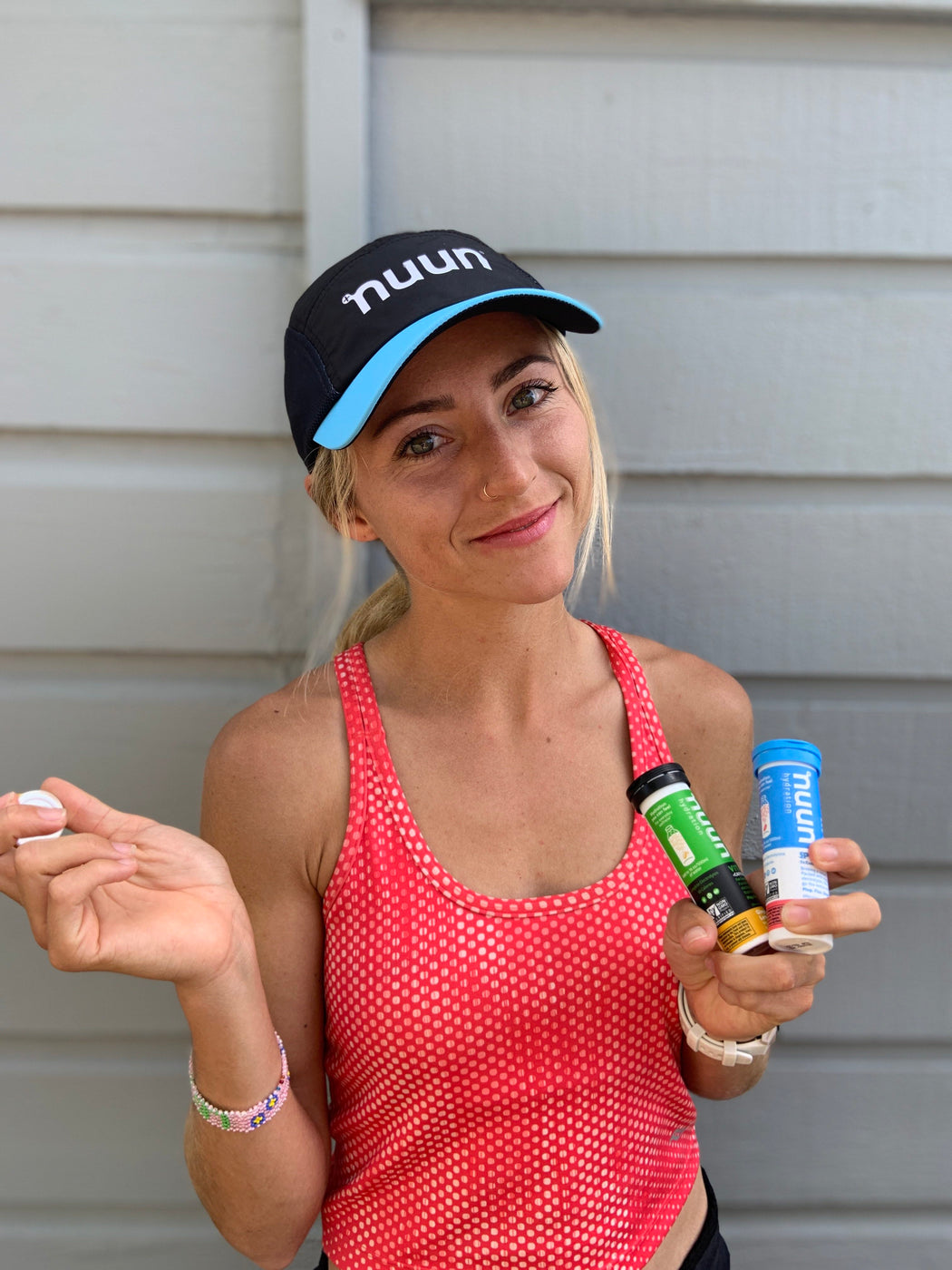 Grayson Murphy with nuun tubes in her hands