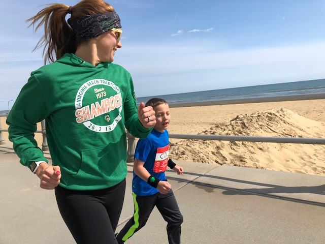 Kara Goucher and child on a run