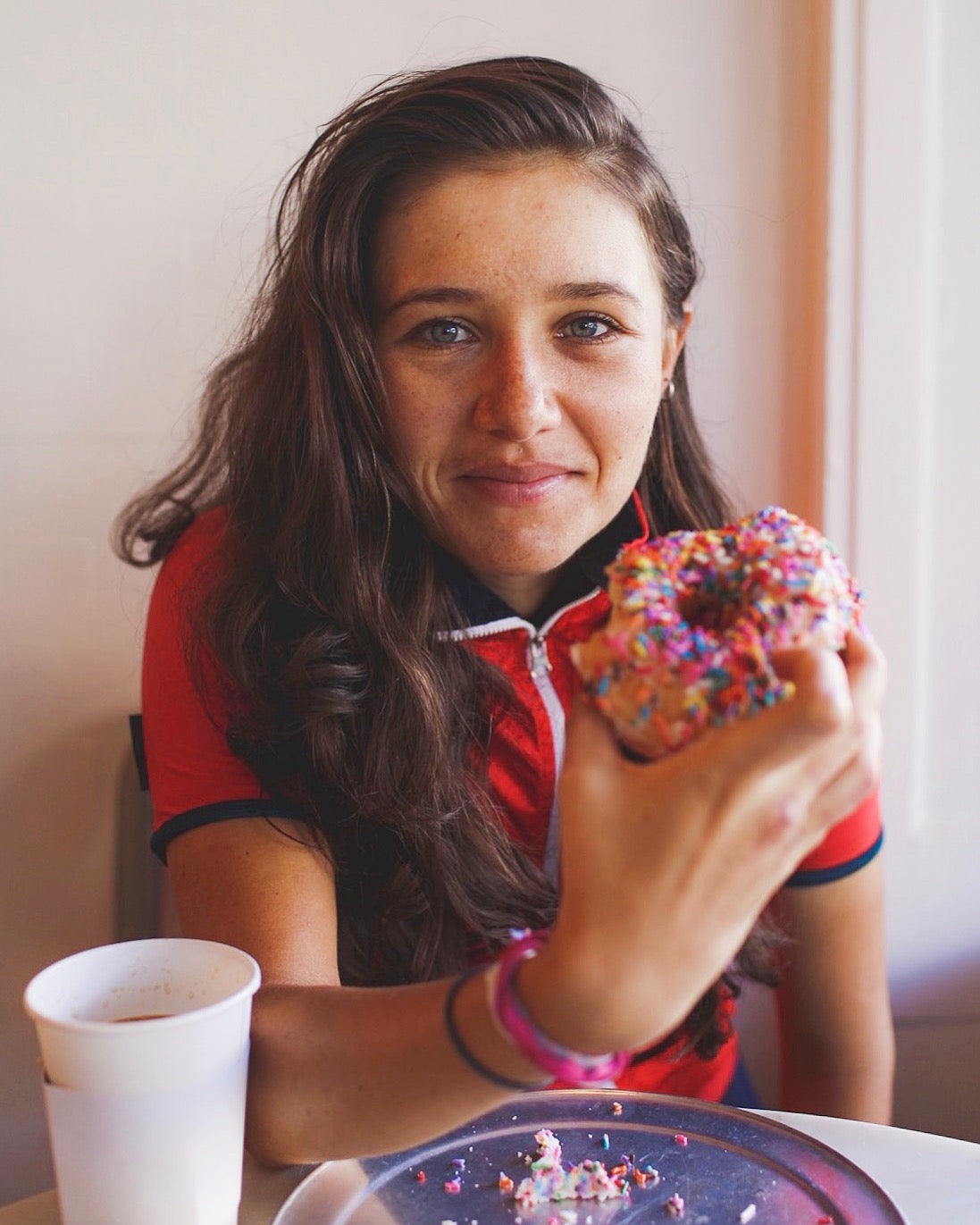 Libby Caldwell refueling with a donut after a workout