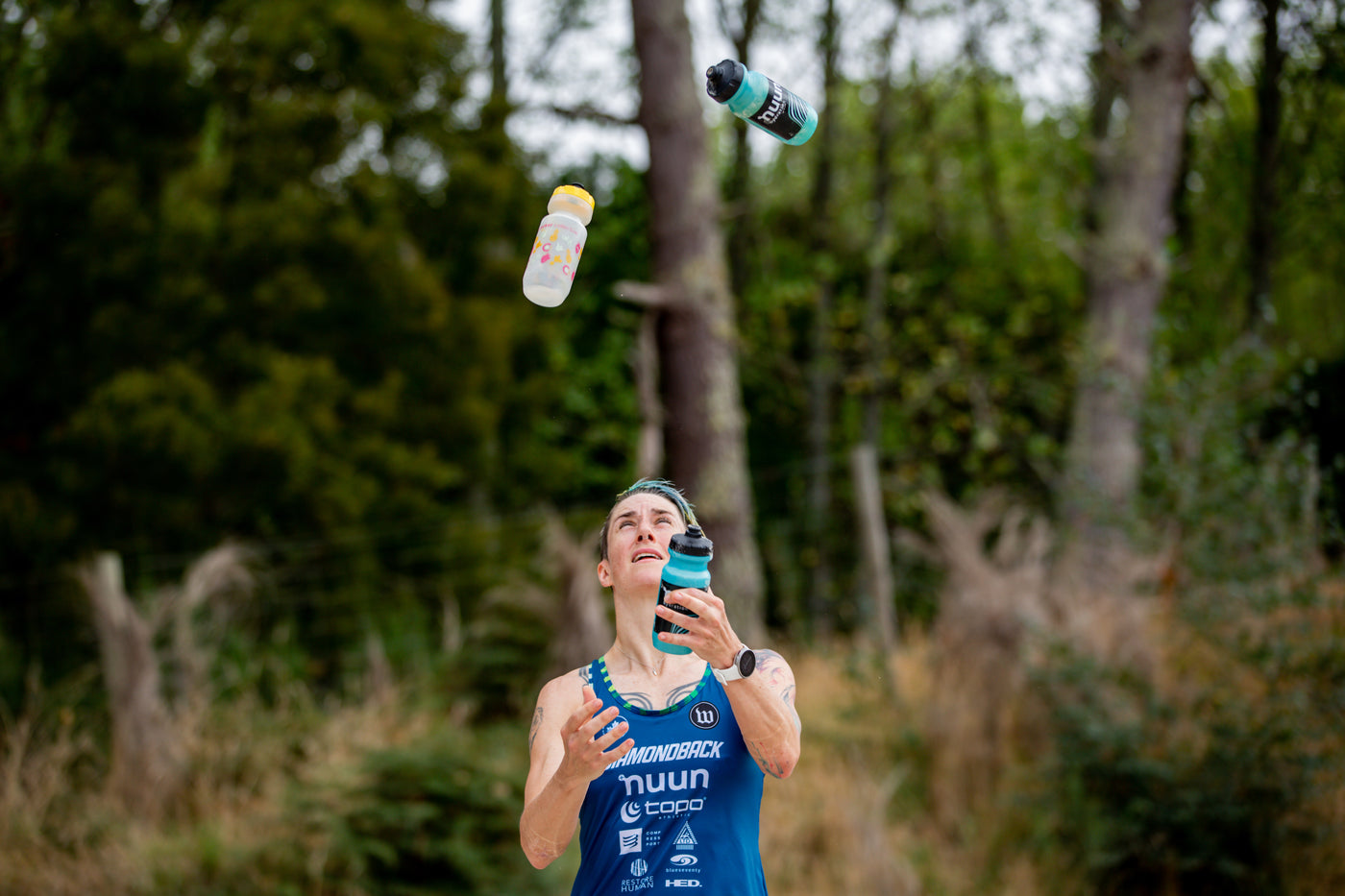 Rachel Mcbride juggling three nuun water bottles