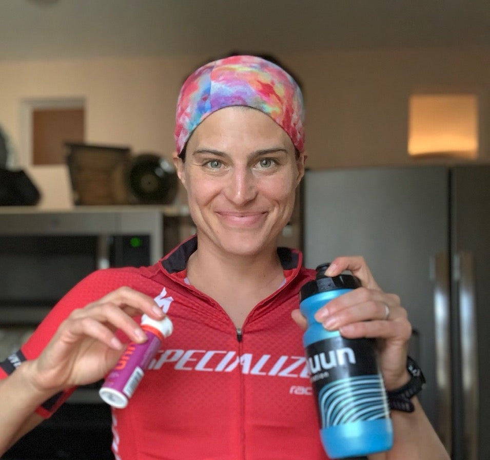 Sarah True smiling with a nuun tube and nuun water bottle