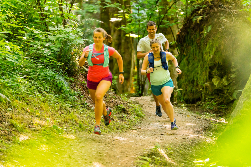 three trail runners in nature