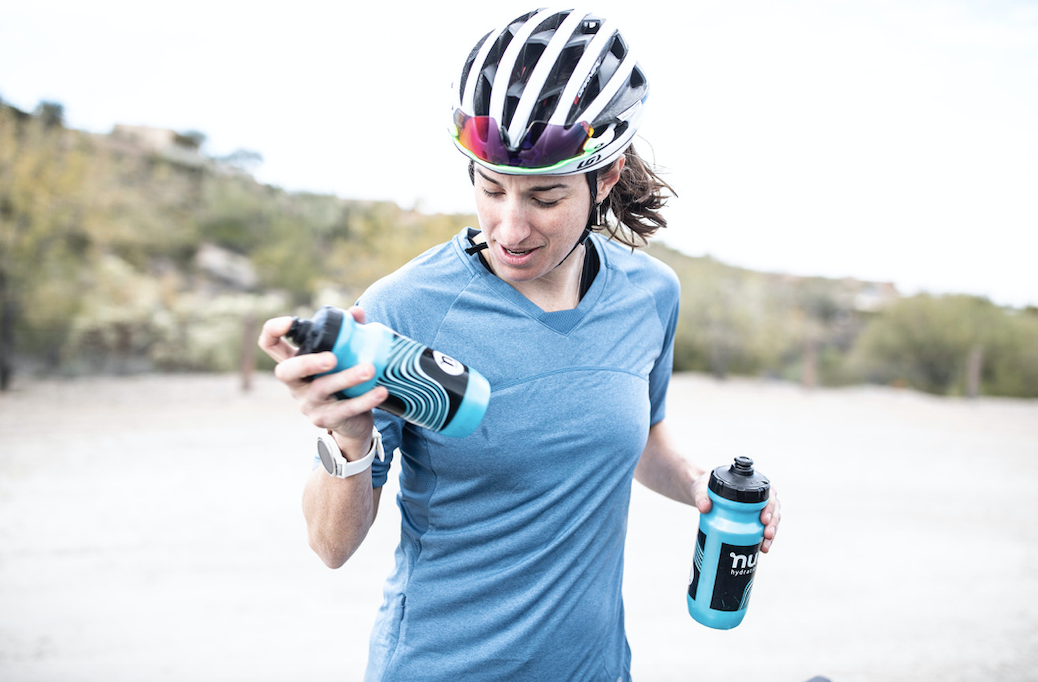 Lea Davidson holding two nuun hydration water bottles