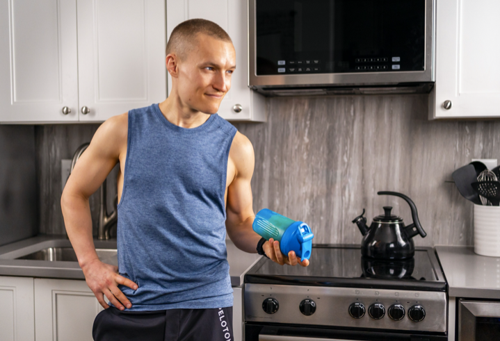 Matt Wilpers in a kitchen with a nuun hydration shaker bottle