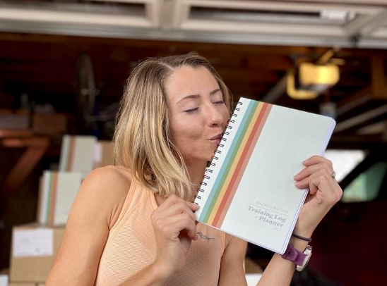 Grayson Murphy playfully kisses her planner