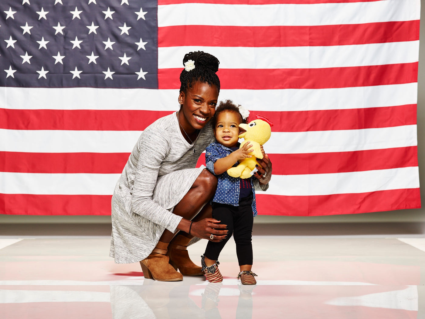 Alysia Montano and child in front of the American flag