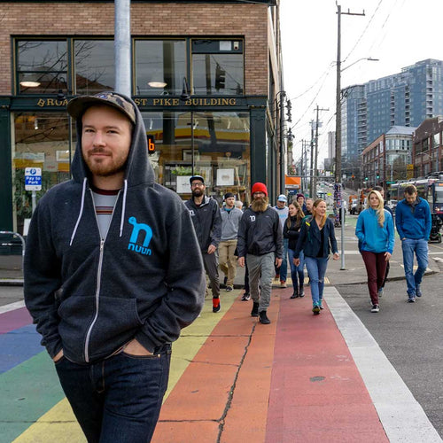 Nuun employees crossing one of Seattle's rainbow crosswalks