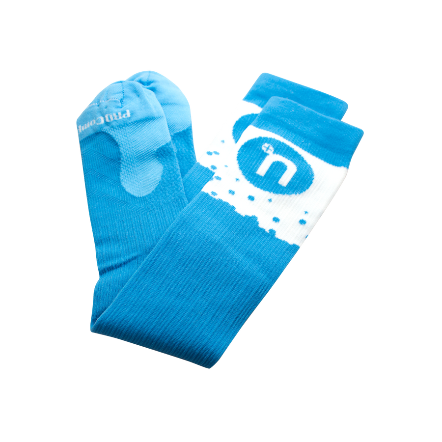 Light blue compression socks with blue and white Nuun logo
