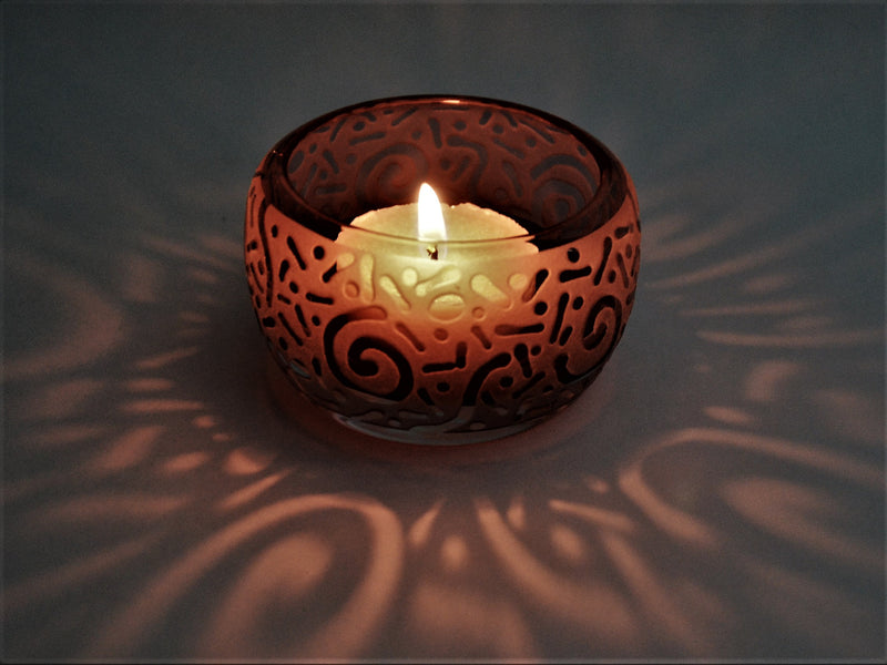 products/Amethyst_Tealight_Votive_Circle_Millennium_Design_with_lit_candle_cast_design_-_It_s_A_Blast_Glass.JPG