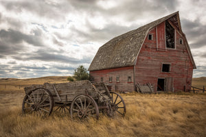 Abandoned barn and wagon on the backroads of Saskatchewan