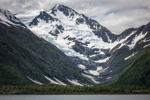 Byron Peak and its glacier rises up from Portage Lake, Alaska