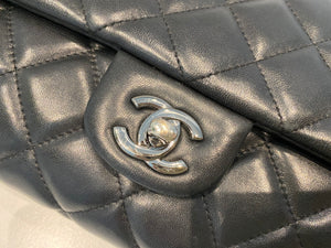 Authentic preowned Chanel clutch chain with black lambskin