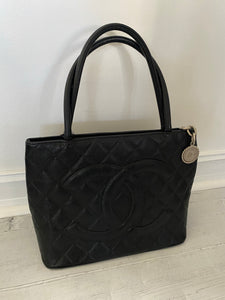 Authentic Chanel preowned black caviar medallion tote with silver hardware