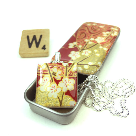 A Scrabble Tile Pendant and Teeny Tiny Tin Chiyo Wine