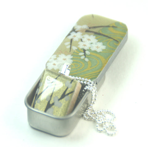 A Scrabble Tile Pendant and Teeny Tiny Tin Golden Green