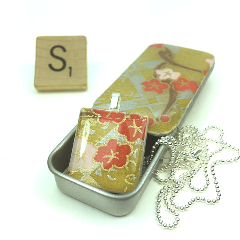 A Scrabble Tile Pendant and Teeny Tiny Tin Kim Gold
