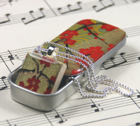 A Scrabble Tile Pendant and Teeny Tiny Tin Golden Blossom Red