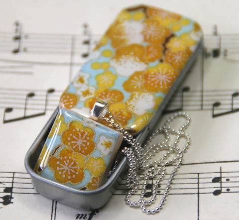 A Scrabble Tile Pendant and Teeny Tiny Tin Sakura Yellow
