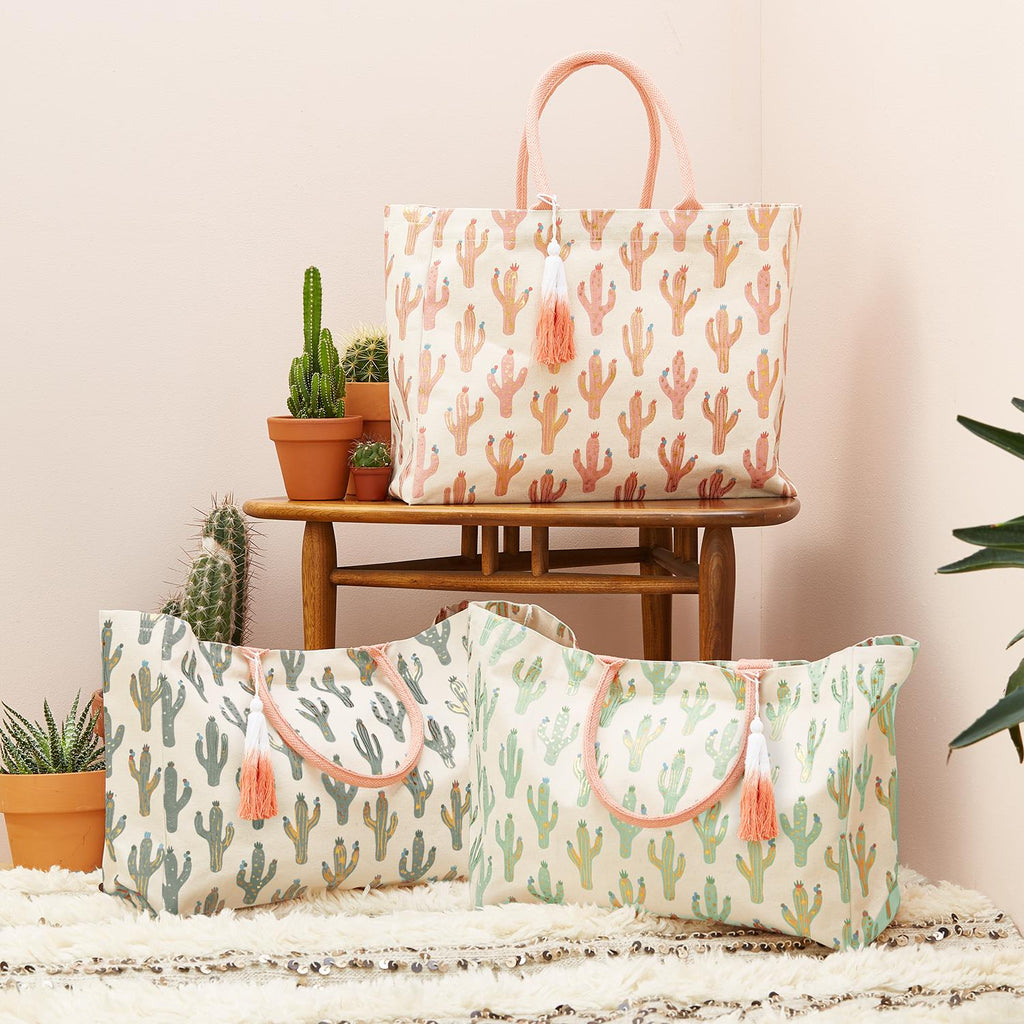 "You will be ""LOOKING SHARP"" when you step out with this Cotton Canvas Cactus Tote Bag!  Metallic accented cactus pattern with solid color handles and tassel trim is available in 3 colorations: Pink, Dark Green, Light Green  Generous size (27"" x 17"" x 8.25"") easily accommodates all your needs for a few days away!"