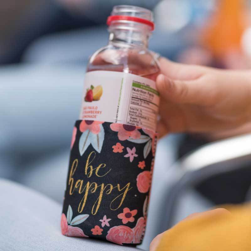 "Inspirational sentiment, ""Be Happy"" and fun artwork makes this pocketed drink sleeve, from the Simple Inspirations Collection, a practical, inspirational & fun treat for yourself or a friend."