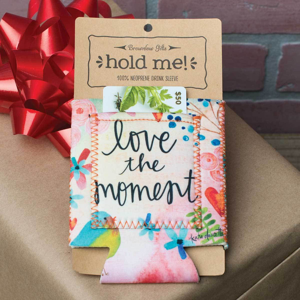 "Inspirational sentiment, ""Love The Moment"", and fun artwork makes this pocketed drink sleeve, from the Simple Inspirations Collection, a practical, inspirational & fun treat for yourself or a friend."