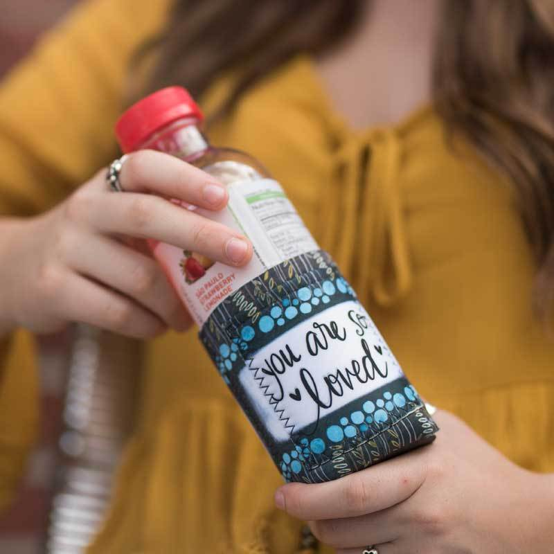 "Inspirational sentiment, ""You Are So Loved"", and fun artwork makes this pocketed drink sleeve, from the Simple Inspirations Collection, a practical, inspirational & fun treat for yourself or a friend."
