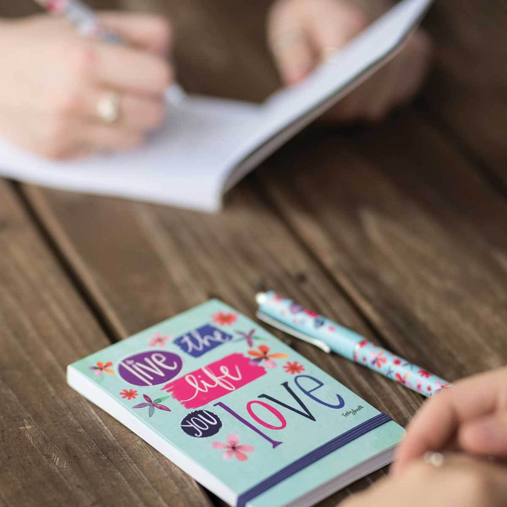 With 136 lined pages and elastic band closure, our Simple Inspirations Live The Life You Love Pocket Notepad features fun floral artwork, along with an inspiring & motivational message from artist, Katie Doucette.