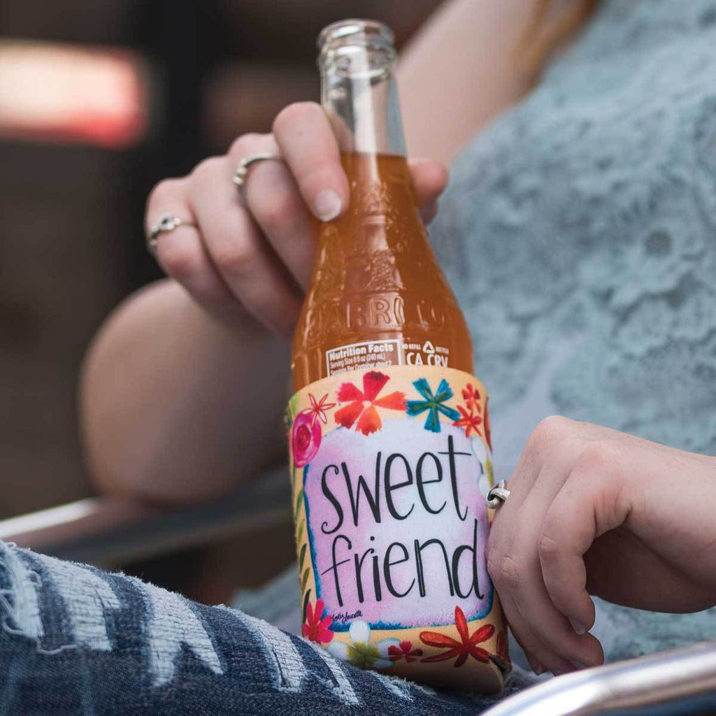 "Inspirational sentiment, ""Sweet Friend"" and fun artwork makes this pocketed drink sleeve, from the Simple Inspirations Collection, a practical, inspirational & fun treat."