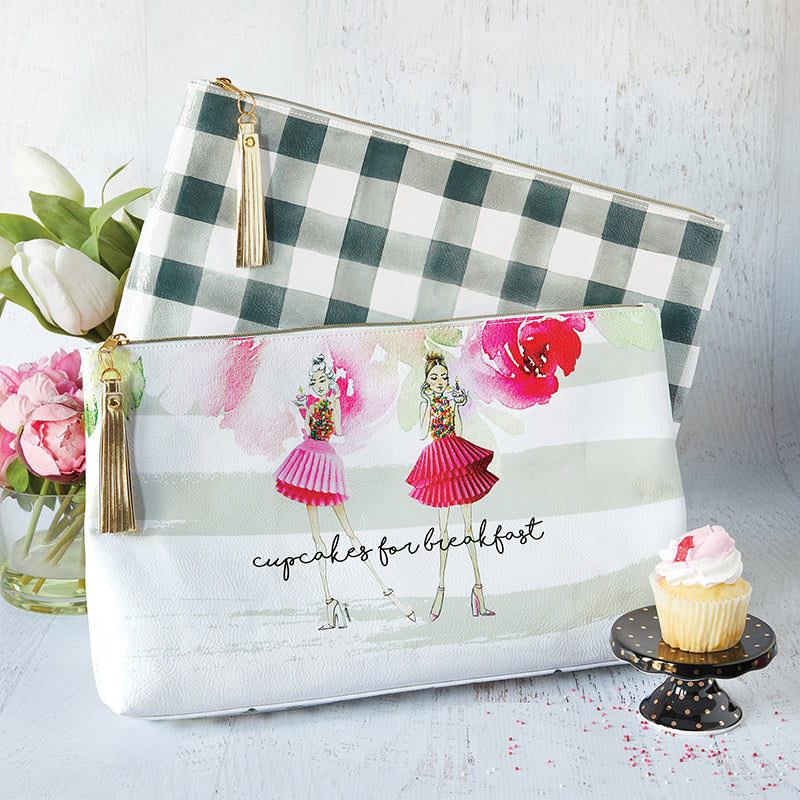 "16"" x 9"" x 2"" ""Cupcakes for Breakfast"" Oil Cloth Bag leaves nothing to be desired - gold tone zipper and metallic tassel are the perfect accent for the signature style artwork from artist, Meredith Wing."