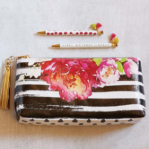 "Perfectly sized at 10"" W x 5"" H x 2"", this ""Paint The Town"" Oil Cloth Bag leaves nothing to be desired - gold tone zipper and metallic tassel are the perfect accent for the doubled-sided floral & stripe artwork of Meredith Wing."