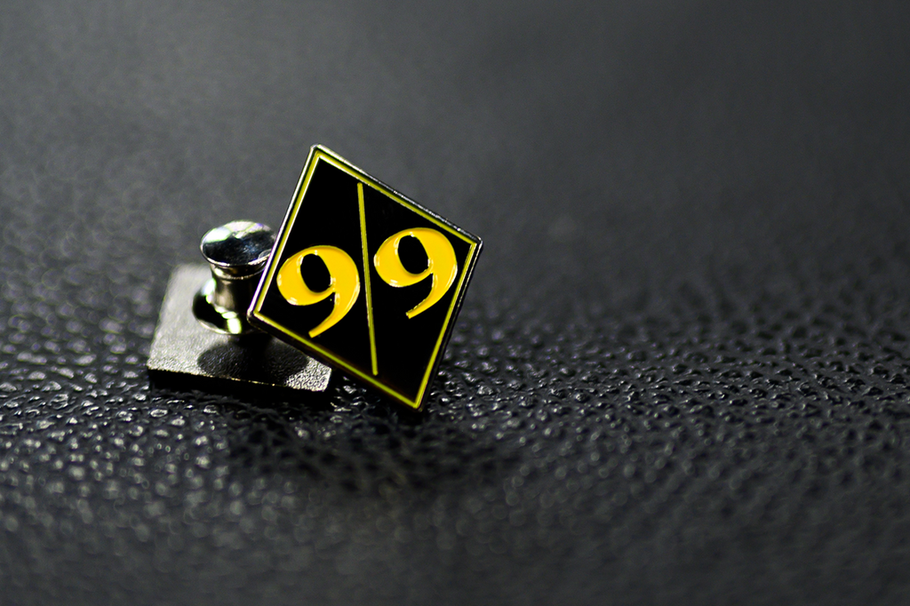 9 For 9 Enamel Pin
