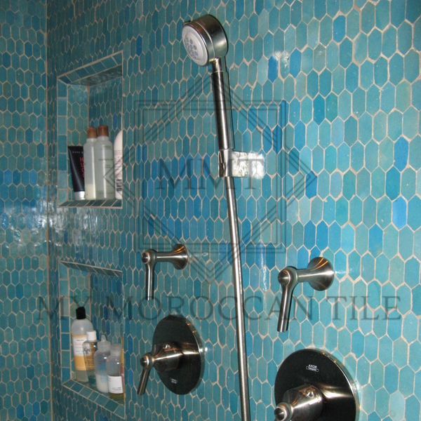 Beautiful master bathroom with turquoise blue moroccan mosaic tile honeycomb hexagonal tile