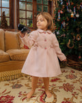 Pink overcoat belted with bows and rose buds