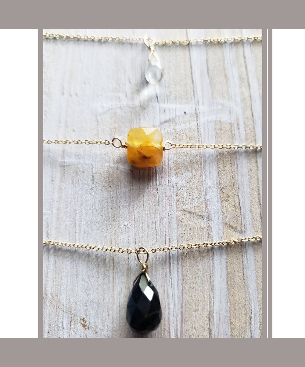 Tiny Black Onyx Tear Drop Necklace layered with yellow garnet and aquamarine