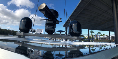 Custom black double radar mast for Riviera Yachts. Furuno open array, Furuno closed dome, SC33, Navigation lights, weather station.