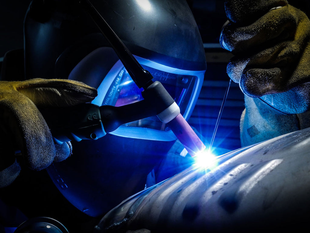 Welder wearing protective glasses
